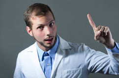 Closeup portrait of handsome young doctor giving a Stock Images
