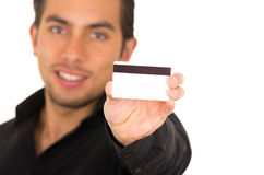 Closeup portrait of handsome young man holding Stock Photos