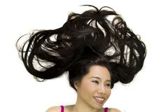 Closeup portrait of happy asian women  lying on ground with black long hair. acting smile, fun stock image