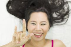 Closeup portrait of happy asian women  lying on ground with black long hair. acting smile, fun royalty free stock image