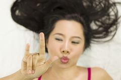 Closeup portrait of happy asian women  lying on ground with black long hair. acting smile, fun royalty free stock photo
