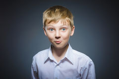 Closeup Portrait of happy boy going surprise isolated on gray background royalty free stock photography