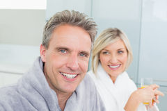 Closeup portrait of a happy couple in bathrobes Royalty Free Stock Photography