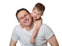 Closeup portrait of a happy father and son together. Portrait of a caring young father giving his son piggyback ride against white background stock image