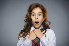 Closeup Portrait of happy girl going surprise on gray background royalty free stock images