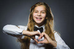 Closeup portrait happy girl shows hands in shape of heart Stock Photos