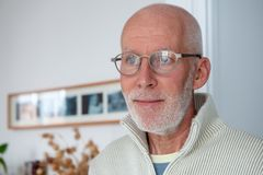 Closeup portrait of happy handsome mature man with glasses royalty free stock photos