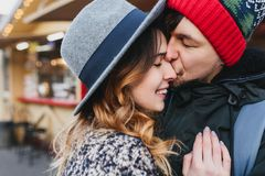 Closeup portrait happy lovely couple chilling outdoor on street on christmas time. Romantic moments,taking care, real stock image