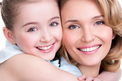 Closeup portrait of happy mother and young daughter Stock Photo