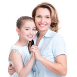 Closeup portrait of happy mother and young daughter Royalty Free Stock Images