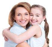 Closeup portrait of happy mother and young daughter. CLoseup portrait of happy white mother and young daughter - isolated. Happy family people concept royalty free stock photos