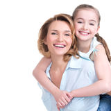 Closeup portrait of happy mother and young daughter. CLoseup portrait of happy white mother and young daughter - isolated. Happy family people concept stock photo