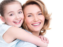 Closeup portrait of happy mother and young daughter Stock Photos