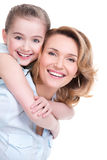 Closeup portrait of happy mother and young daughter. CLoseup portrait of happy white mother and young daughter - isolated. Happy family people concept royalty free stock photography