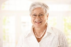 Closeup portrait of happy senior woman Stock Image