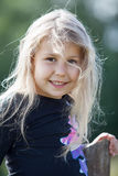 Closeup portrait of happy small girl with wild hair Royalty Free Stock Photography