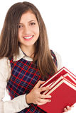 Closeup portrait of happy student  holding a pile of books Royalty Free Stock Photos