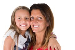 Closeup portrait of happy white mother and young daughter isolated on white wall in Happy family people concept stock images
