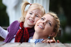 Closeup portrait of happy white russian mother and young daughter Royalty Free Stock Images