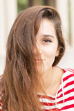 Closeup portrait of happy woman covers her face with hair, hairs Royalty Free Stock Image