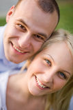 Closeup portrait of happy young couple. Closeup outdoors portrait of happy young smiling couple Royalty Free Stock Image