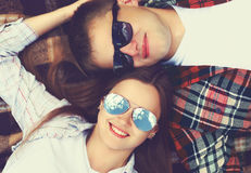 Closeup portrait of happy young couple in sunglasses lying Royalty Free Stock Image
