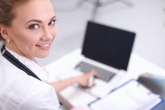Closeup portrait of a happy young doctor sitting stock images