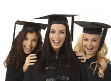 Closeup portrait of happy female graduates Stock Photos