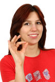 Closeup portrait of a happy young lady gesturing Royalty Free Stock Photo