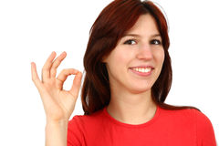 Closeup portrait of a happy young lady gesturing Royalty Free Stock Photos