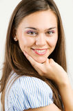 Closeup portrait of a happy young woman smiling. Isolated in white Stock Photography