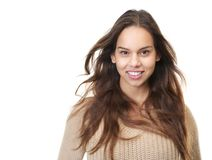 Closeup portrait of a happy young woman smiling. Close up portrait of a happy young woman smiling with hair blowing isolated on white Royalty Free Stock Photo