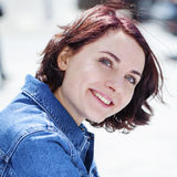 Closeup portrait of a happy young woman smiling. Summer street outdoors Royalty Free Stock Photos