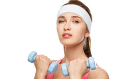 Closeup portrait healthy athletic woman lifting weights Royalty Free Stock Image