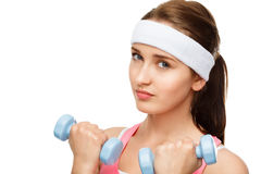 Closeup portrait healthy athletic woman lifting weights Stock Images