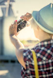 Closeup portrait of hipster girl making selfie on retro camera Stock Photos