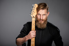 Closeup portrait of hipster man with guitar Royalty Free Stock Photography