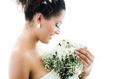 Closeup portrait of hispanic bride holding flower Stock Image