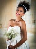 Closeup portrait of hispanic bride holding flower Royalty Free Stock Images