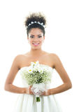 Closeup portrait of hispanic bride holding flower Stock Photography