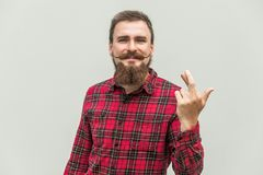 Closeup portrait hopeful beautiful bearded man crossing his fing. Ers, , hoping, asking best  on gray background. Human face expression, emotions, feeling Royalty Free Stock Photography