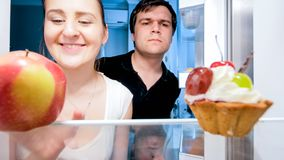 Closeup portrait of hungry young couple looking for something to eat at night. Closeup portrait of hungry couple looking for something to eat at night stock images