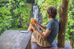 Free Closeup Portrait Image Of A Beautiful Man Drinking Ice Tea With Feeling Happy In Green Nature And Waterfall Garden Royalty Free Stock Photos - 153069108
