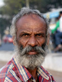 Closeup portrait of a Indian vendor on a busy road Stock Images