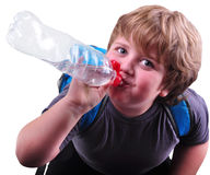 Closeup portrait of kid drinking water Stock Photos
