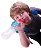 Closeup portrait of kid drinking water Royalty Free Stock Image