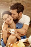 Closeup portrait of kissing couple. Closeup portrait of happy kissing couple embracing in the morning Royalty Free Stock Photo