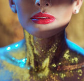Closeup portrait of a lady with golden neck. Closeup portrait of a lady with a golden neck Royalty Free Stock Images