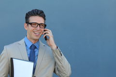 Closeup portrait of laughing young business man with glasses and wide open mouth talking on mobile phone outdoors Royalty Free Stock Image