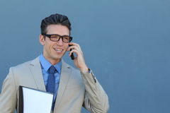 Closeup portrait of laughing young business man with glasses and wide open mouth talking on mobile phone outdoors royalty free stock photography